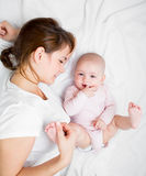 Happy mother playing with her baby infant Stock Photography