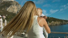 Happy mother playing with her little son outdoors stock video footage