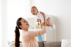 Happy mother playing with little baby boy at home Stock Photos