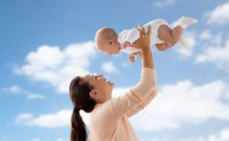 Happy mother playing with little baby boy over sky Royalty Free Stock Photos