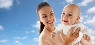 Happy mother playing with little baby boy over sky Stock Images