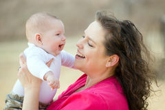 Happy mother playing with smiling, happy baby Stock Images