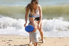 Happy Mother Playing With Son On Beach Royalty Free Stock Photography