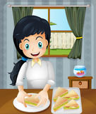 A happy mother preparing sandwiches Stock Photography