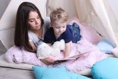 Happy mother reads book for her little son Royalty Free Stock Image