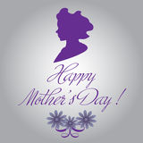 Happy Mother's Day. Abstract colorful background with female head silhouette, flowers and the text Happy Mother's Day written with handwritten letters Stock Image