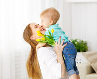 Happy mother`s day. Baby son gives flowers for mom. Happy mother`s day. Baby son congratulates mom, gives her flowers royalty free stock photos