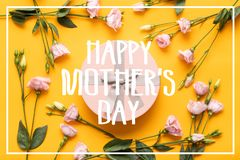 Happy Mother`s Day Background. Bright Yellow and Pastel Pink Colored Mother Day Background. Flat lay greeting card with gift box. stock photo