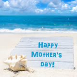 Happy mother`s day background with seashell on the sandy beach Royalty Free Stock Photography