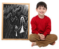 Happy Mother's Day Boy with Clipping Path. Adorable six year old school boy with Mother's Day message on chalkboard with clipping path over white Royalty Free Stock Images