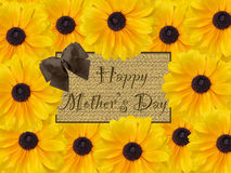 Happy Mother's Day brown rustic card with yellow daisy flower background Stock Images