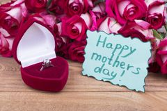 Happy mother`s day card and ring. Roses, ring in a box and postcard. Gift for beloved mother on holiday royalty free stock photography