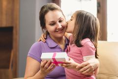 Happy Mother`s Day Celebrating Concept. Child Daughter Giving Present to Her Mom royalty free stock photography