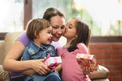 Happy Mother`s Day Celebrating Concept. Child Daughters Giving Present to Their Mom royalty free stock photography