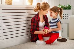 Happy mother`s day! Child daughter congratulates moms and gives Stock Photography