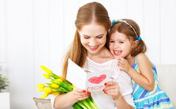 Happy mother`s day! Child daughter congratulates moms and gives Royalty Free Stock Images