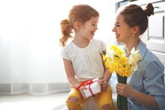 Happy mother`s day! child daughter   gives mother a bouquet of f Royalty Free Stock Photo