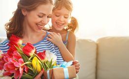 Happy mother`s day! child daughter   gives mother a bouquet of f Stock Photo