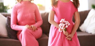 Happy mother`s day! child daughter gives mother a bouquet of flowers and postcard royalty free stock photos
