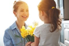 Free Happy Mother`s Day! Child Daughter   Gives Mother A Bouquet Of F Stock Photo - 113750000