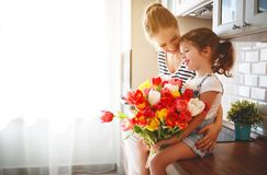 Happy mother`s day! child daughter   gives mother a bouquet of f Stock Images