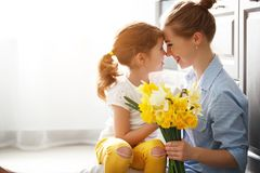 Happy mother`s day! child daughter   gives mother a bouquet of f Stock Photos