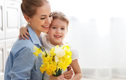 Happy mother`s day! child daughter gives mother a bouquet of f. Happy mother`s day! child daughter congratulates mother and gives a bouquet of flowers to royalty free stock photos