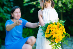 Happy mother`s day! Child girl congratulates mom and gives her b stock photography