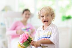 Happy mother's day. Child with present for mom stock photography