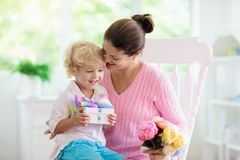 Happy mother's day. Child with present for mom stock image