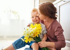 Happy mother`s day! child son gives flowersfor  mother on holiday royalty free stock images