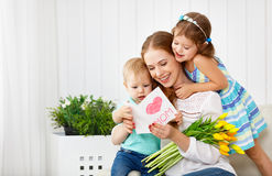 Happy mother`s day! Children congratulates moms and gives her a