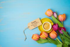 Free Happy Mother`s Day Concept With Coffee Cup And Beautiful Tulip Flowers On Wooden Background. Top View From Above Stock Photo - 179652240