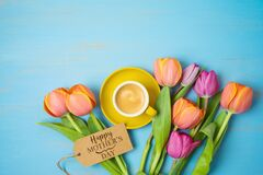 Free Happy Mother`s Day Concept With Coffee Cup And Beautuful Tulip Flowers On Woooden Background. Top View From Above Stock Photo - 179652010