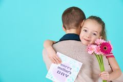 Happy Mother`s Day. Cute little girl giving mom mothers day card and flowers. Mother and daughter concept. Happy Mother`s Day. Cute little girl giving mom Stock Images