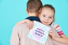 Happy Mother`s Day. Cute little girl giving mom mothers day card. Mother and daughter concept. Happy Mother`s Day. Cute little girl giving mom mothers day card royalty free stock images
