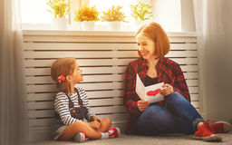 Happy mother`s day! Daughter gives her mother an postcard Stock Images