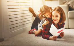 Happy mother`s day! Daughter gives her mother an postcard. And hugs Royalty Free Stock Photography