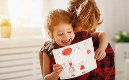 Happy mother`s day! Daughter gives her mother an postcard Stock Photos