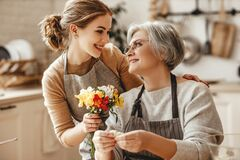 Free Happy Mother`s Day! Family Old Grandmother  Mother-in-law And Daughter-in-law Daughter Congratulate On   Holiday, Give Flowers Royalty Free Stock Image - 173005466