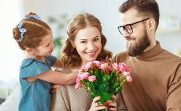 Happy mother`s day! father and child congratulate mother on holiday. Happy mother`s day! father and child daughter congratulate mother on holiday and give stock photography