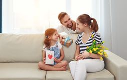 Happy mother`s day! father and child congratulate mother on holi Stock Image