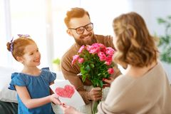 Happy mother`s day! father and child congratulate mother on holiday. Happy mother`s day! father and child daughter congratulate mother on holiday and give royalty free stock photography