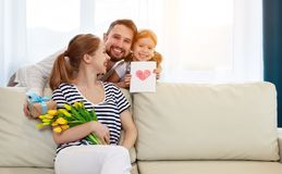 Happy mother`s day! father and child congratulate mother on holi Stock Photo