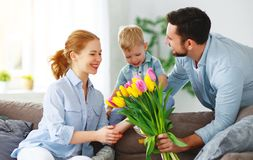 Happy mother`s day! father and child congratulate mother on holiday royalty free stock images