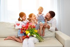 Happy mother`s day! father and children congratulate mother on h Royalty Free Stock Image