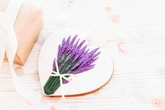 Happy mother`s day greeting card. cookie heart with lavender bou. Quet and craft gift box on white rustic wooden background with confetti. space for text . happy Stock Photo