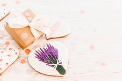 Happy mother`s day greeting card. cookie heart with lavender flo. Wers and craft gift box on white rustic wood background with confetti flat lay. space for text Royalty Free Stock Photos