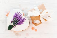 Happy mother`s day greeting card. cookie heart with lavender flo. Wers and craft gift box on white rustic wood background  flat lay. space for text. happy Royalty Free Stock Photography