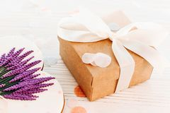Happy mother`s day greeting card. cookie heart with lavender flo. Wers and craft gift box on white rustic wood background  flat lay. space for text. happy Stock Photo